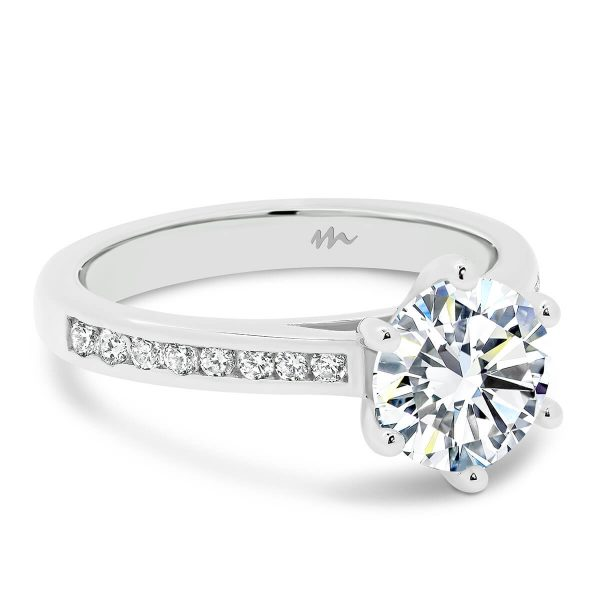 Andie Round Moissanite 6-prong engagement ring with channel set moissanite band