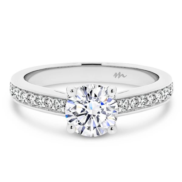 Bianca designed Moissanite ring with round centre stone and pave band.