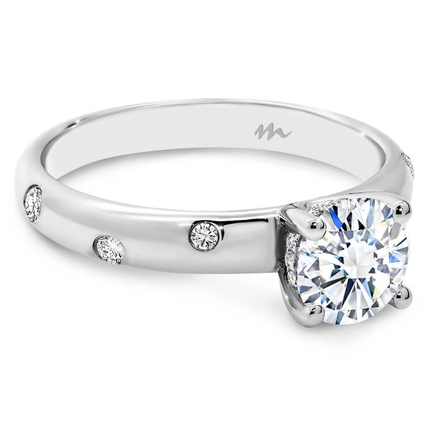 Cecilia 4 Prong Round Brilliant Moissanite ring with a random hammer set band