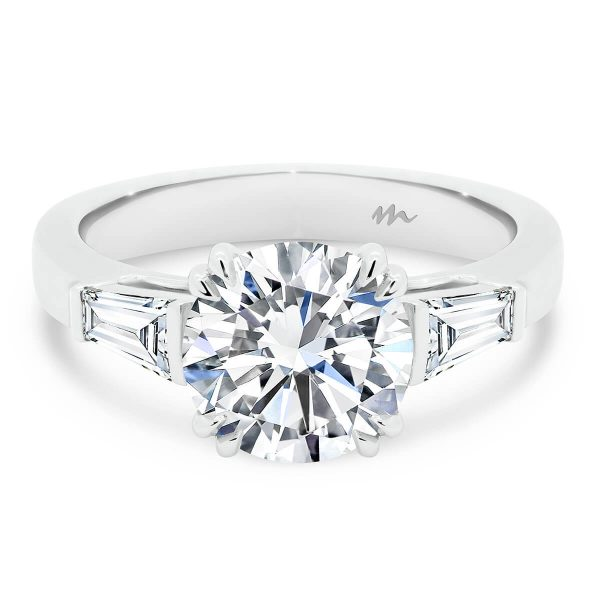 Debbie Round Moissanite engagement ring with tapered baguettes