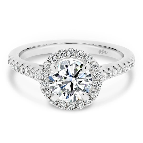 Delta halo Moissanite engagement ring with sparkling Moissanite jewels on the band.