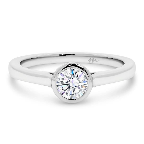 Imogen Round' Moissanite engagement ring bezel set 0.50 carat centre on half rounded band