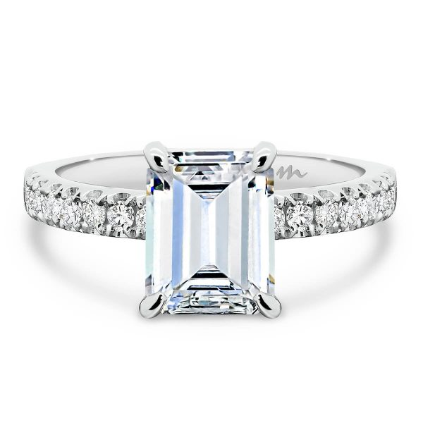 Janet Emerald Moissanite engagement ring with 4-prong basket setting on delicate prong set half band