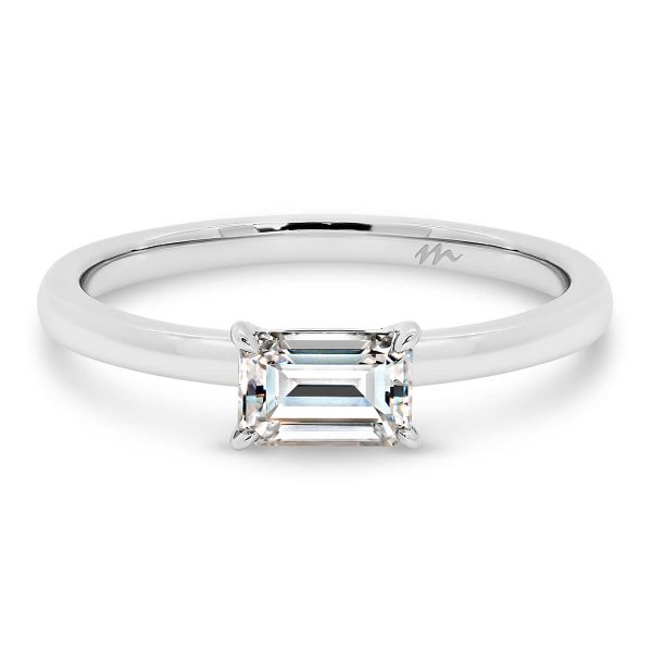 Jolie Emerald solitaire Moissanite ring with East-West stone on fine plain band