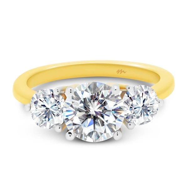 Kiara 4 prong trilogy ring with 3 prong set side stones on tapered band