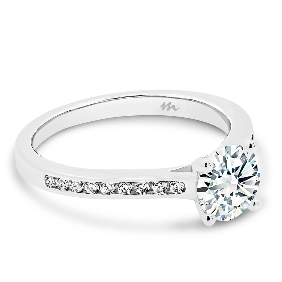 London 4 claw round moissanite ring with channel set band