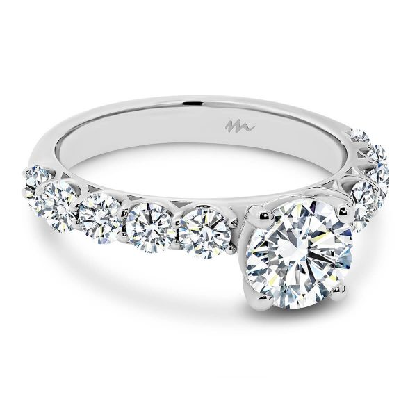 Maxine 6.5 Moissanite engagement ring with 1 carat Round stone on 4-prong setting on prong set band of stones