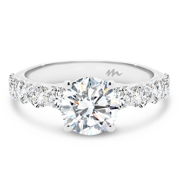 Maxine 7.5 Moissanite engagement ring with pave set under rail and prong set stones on the band