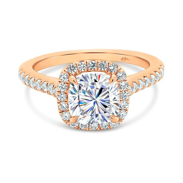 May design Moissanite halo engagement ring with diamond accents under gallery.