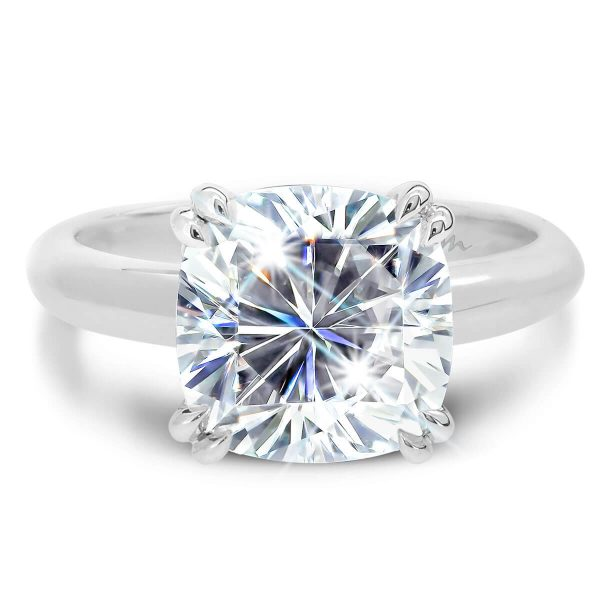 Monica Cushion solitaire ring double prongs on knife edge band.