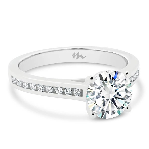 Nicole channel set engagement ring with a large Moissanite centre.