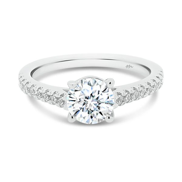 Nouvelle Moissanite ring with a crossover prongs and a thin prong set band.