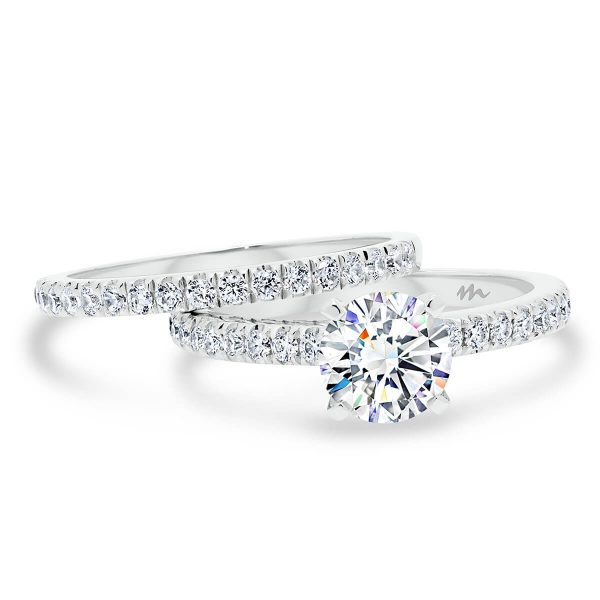 Payton A delicate prong set Moissanite wedding ring