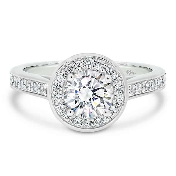 Simona Round with its pave halo and pave band is a stunning engagement ring choice.
