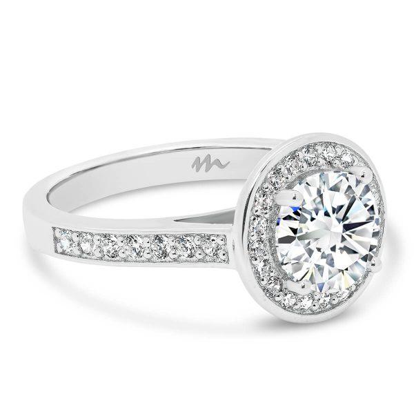Simona round halo Moissanite ring with pave halo and matching band.