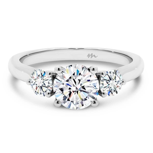 Theresa three stone Moissanite engagement ring with 1.00 carat round centre stone and heart shaped gallery