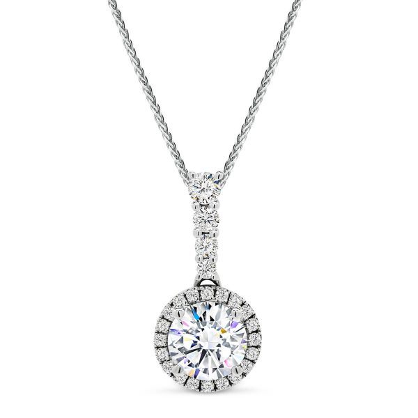 Moissanite vintage halo pendant with diamond encrusted bail.