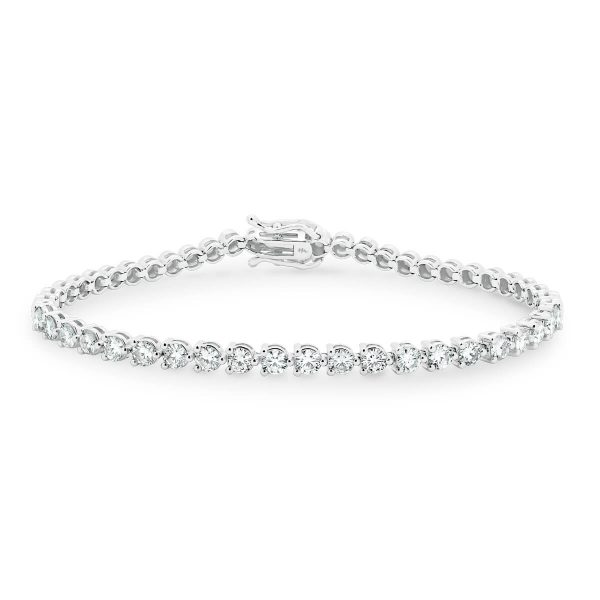 Beatrice' beautiful 3 prong set half tennis bracelet in polished white gold with safety clasp