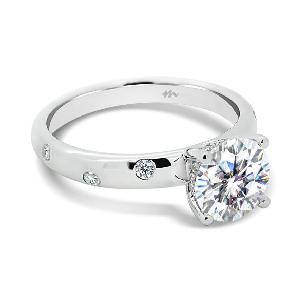 Cecilia 1.5 carat Moissanite engagement ring with 4 prong setting on gypsy set band