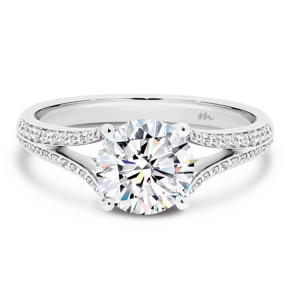 Nevina 4 prong solitaire on graduating pave set open split band