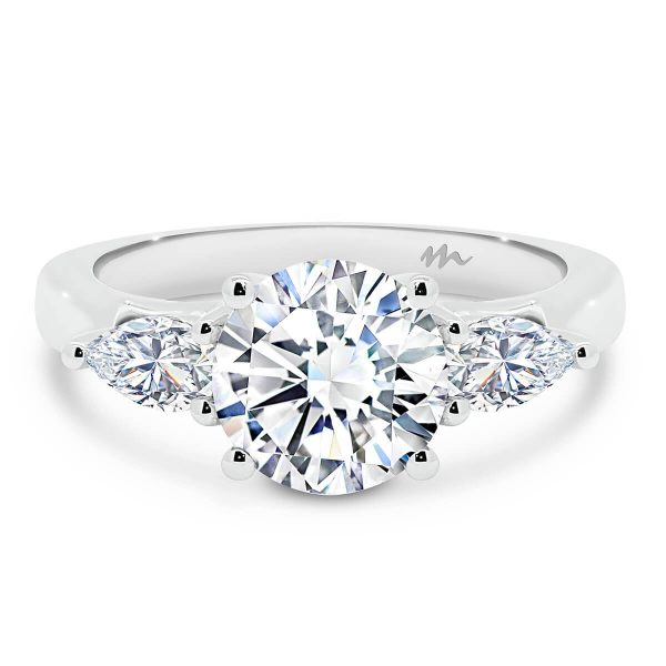 Tara Round trilogy ring with Pear cut side stones