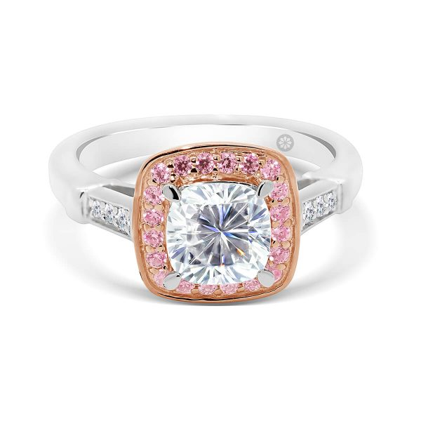 Georgia Cushion pink halo engagement ring with pave set half band and matching jig-saw cut wedding band