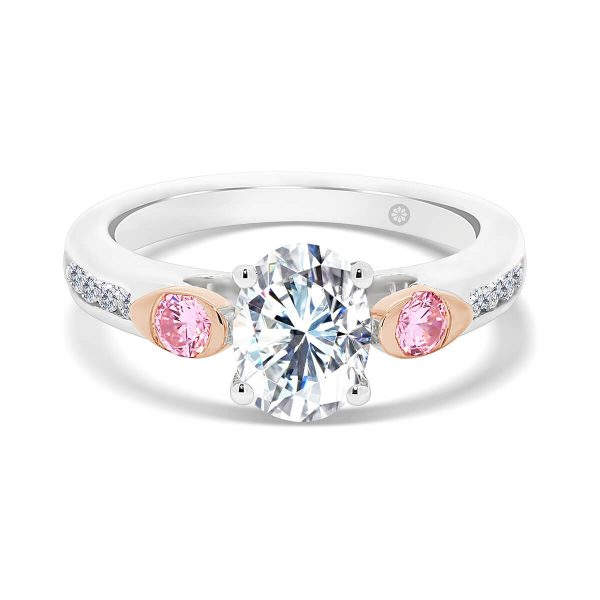Melbourne Oval Pink 4 prong ring with pink side stones in rose gold bezel set and channel set band