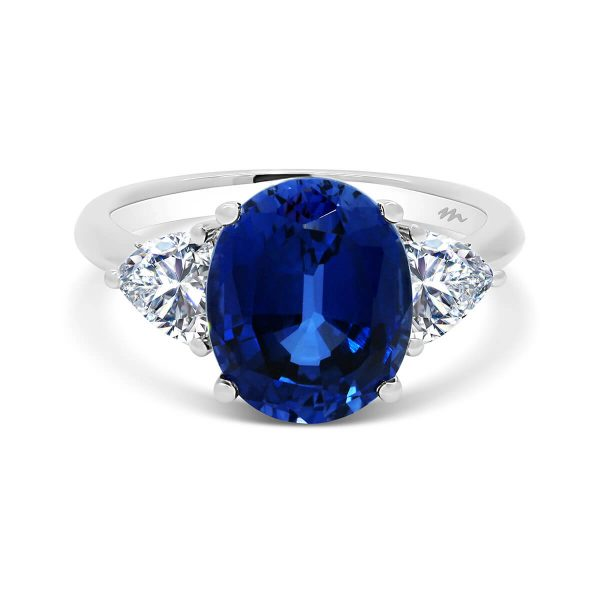 Bluebell 10x8 Oval sapphire trilogy with two trillion-cut moissanite side stone on plain band