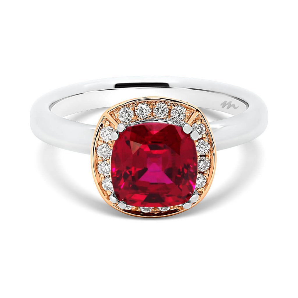 Cedar cushion ruby ring on cushion-shaped halo with ruby accent side stones on rounded plain band