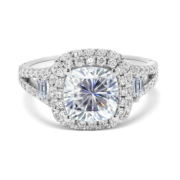 Evangeline cushion-cut ring with rolling halo on a 3/4 split shank with 2x trapezoid side stones
