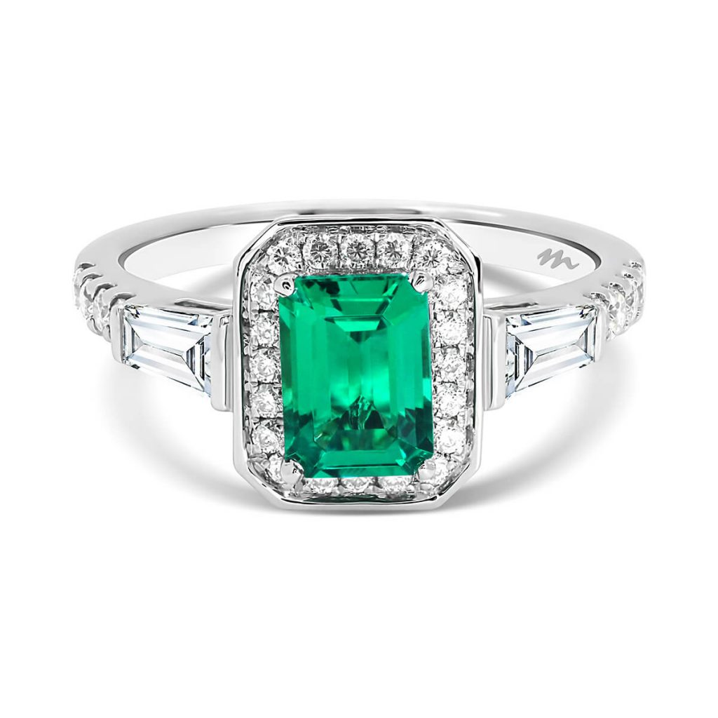 Heather emerald-cut halo ring with emerald centre stone and tapered baguette side stones on prong set band