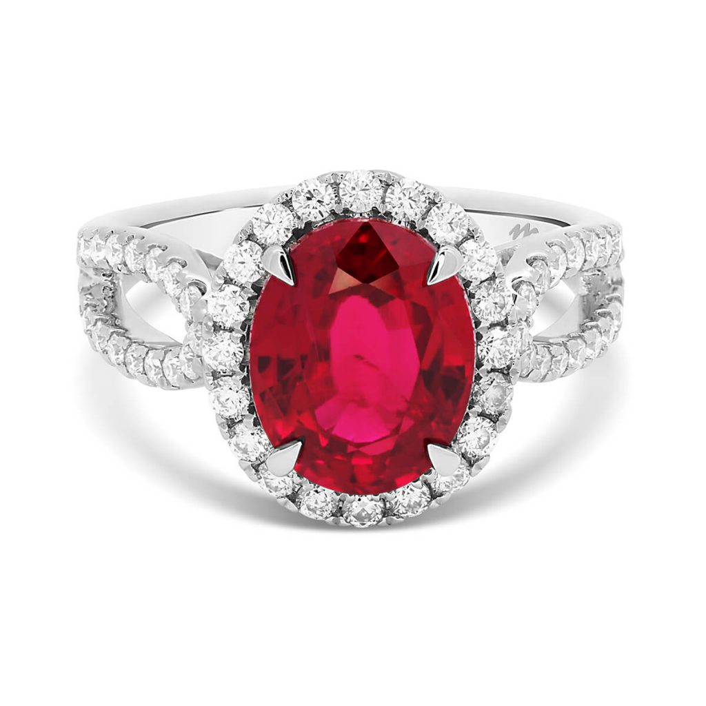 Ivy Red Ruby oval halo ring on filigree basket and split 3/4 shank