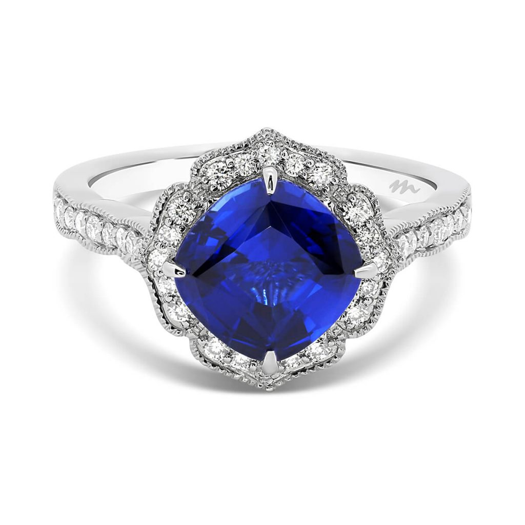 Lavender Blue lab-grown cushion sapphire ring in a floral petal-shaped halo design and pave set band