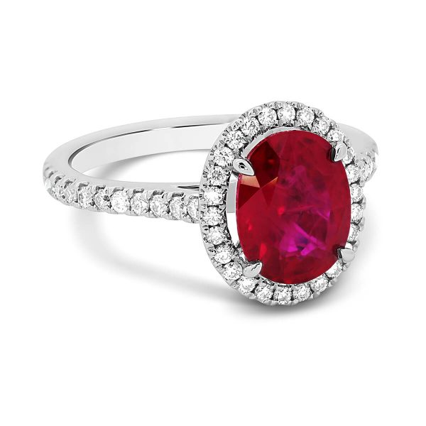 Rosemary Oval 9x7 Red lab-grown ruby in a prong set halo design with 3/4 prong set band