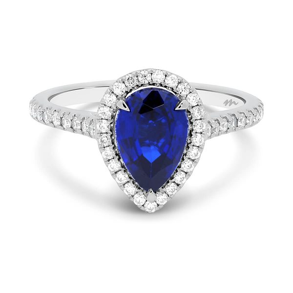 Rosemary 9x6 Pear Blue lab-grown sapphire with prong set halo on 3/4 prong set band