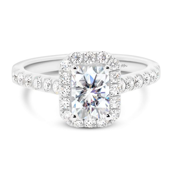 Elongated radiant engagement ring with halo and prong set band