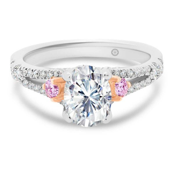 New York Oval 8x6 Pink 4 prong ring with pink side stones on split prong band