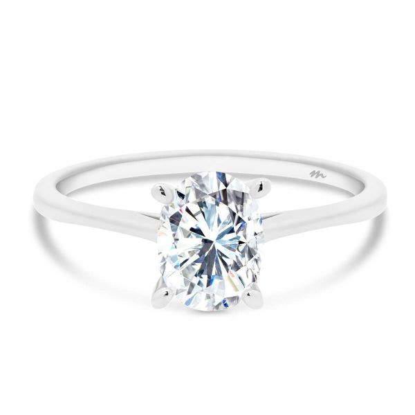 Lanefield Oval 7x5-8x6 four prong solitaire ring with open v gallery and pear tips on slightly tapered band