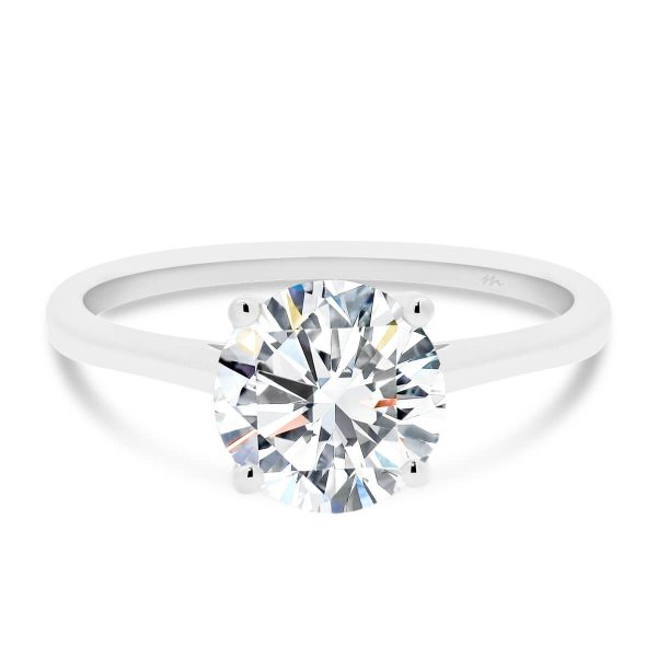 Lanefield Round 7.5-8.0 four prong solitaire ring with open v gallery on slightly tapered band