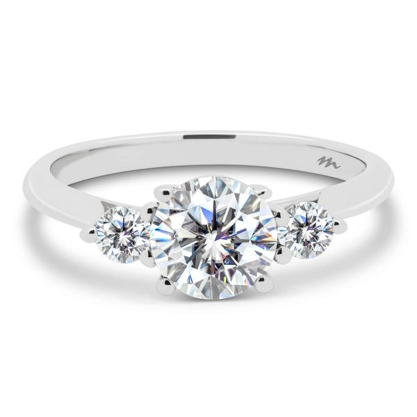Lawnton 4 prong trilogy ring with two 0.10ct side stones on a fine knife-edge band