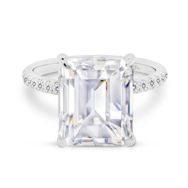 Estella large emerald cut on dlicate prong set half band with micro-pave under-rail